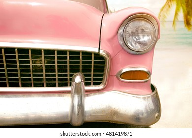 Journey of holiday - front of pink vintage classic car parked side beach in summer