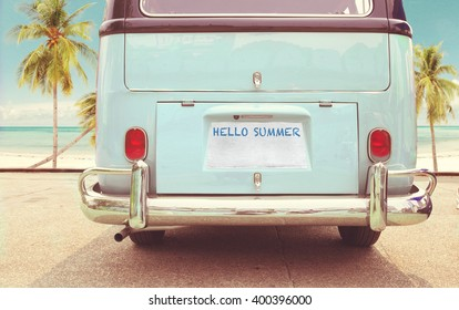 Journey of holiday - Rear of vintage classic van parked side beach in summer
