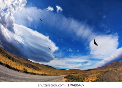 Journey into a far country. Gravel road, incredible forms clouds and Andean condors. The picture was taken Fisheye lens