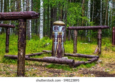 Journey on foot through uncharted roads of a national Park. Wooden vertical poles with the muzzle of a wolf. The place of sacrifice. The secret traditions and rituals of the ancient Slavs.