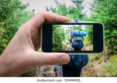 journey through the mountains, photo tourist, tourist photographing people on the smartphone, phone in hand. tourists climb up the mountain, selfie phone