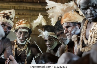 JOW VILLAGE, ASMAT DISTRICT, IRIAN JAYA , NEW GUINEA, INDONESIA - JUNE 28: Group of Asmat with a traditional painting on a face. June 28, 2012 in Jow Village, Asmat, Irian Jaya province, Indonesia