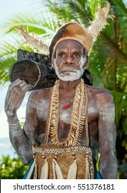 JOW VILLAGE, ASMAT, NEW GUINEA, INDONESIA - JUNE 28: Leader of Asmat tribe with drum (em). The In the village of Asmates goes preparation for of aceremony. June 28, 2012, Jow Village, Asmat, Indonesia