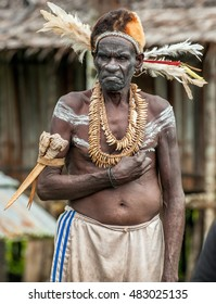 JOW VILLAGE IN JUNGLE, ASMAT DISTRICT, NEW GUINEA, INDONESIA - JUNE 14: Portrait of Headhunter of a Papuan Asmat tribe. June 14, 2016, Asmat area, Irian Jaya province, Indonesia