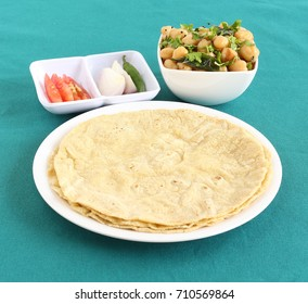 Jowar roti or sorghum flat bread, which is an healthy Indian vegetarian food made from the dough of sorghum flour.