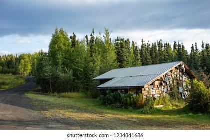 Joy, Alaska - Aug 18, 2018: A view of Joe and Nancy Carlson's Tire Shop in Joy Alaska, USA. The shop is located on Elliott Highway, North of Fairbanks.
