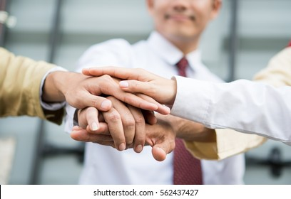 Joy Hand group Teamwork Join Hands Partnership Third party, Arab and Muslim Business clasping hand Concept.