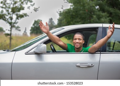 Joyful African American Male Driver Arms Out of Car Window