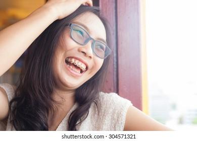 joyful asia woman.woman wear eyeglasses.joy and laugh.