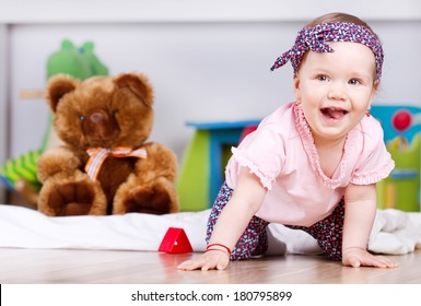 Joyful baby girl laughing