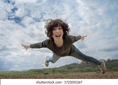 Joyful boy in flight (levitation effect).