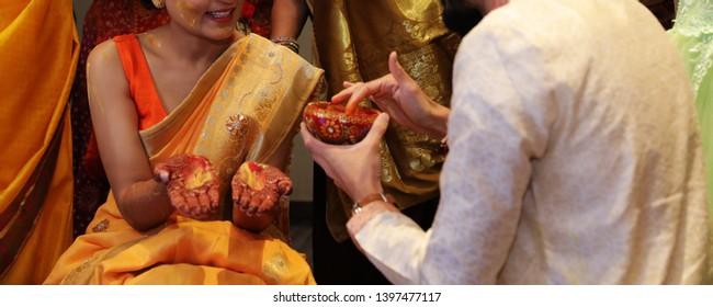 Joyful Brother pasting haldi at her bridal haldi ceremony Karachi, Pakistan, May 01, 2019