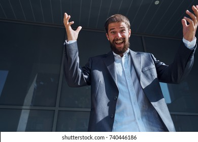 joyful business man smiling at the building background