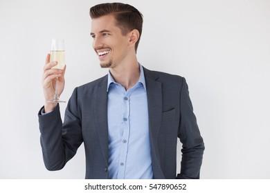 Joyful Business Man Toasting with Glass of Wine