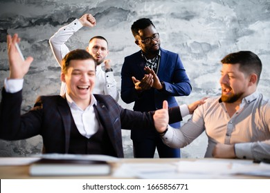 Joyful businessmen rejoicing at the conclusion of a contract for the supply of new goods