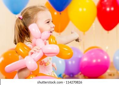 joyful child girl on birthday party