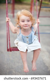 Joyful child swinging on a swing