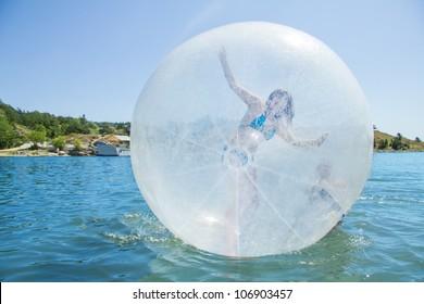 Joyful children in a balloon floating on water.