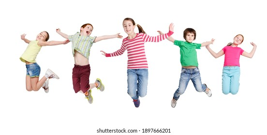 Joyful Children Jumping In Mid-Air Posing And Having Fun Over White Studio Background. Kids Group In Casual Clothes Jump In A Row. Carefree Childhood. Collage, Panorama