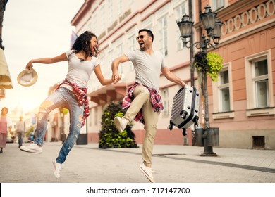 Joyful couple enjoying walking at street. Find your travel partner.