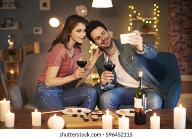 Joyful couple sitting at dining table