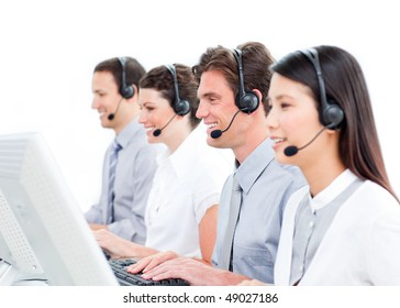 Joyful customer service agents working in a call center against a white background