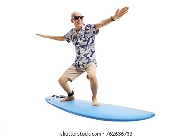 Joyful elderly man surfing isolated on white background