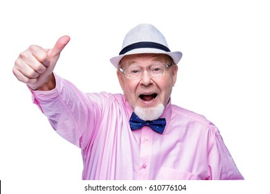 Joyful excited old man showing thumb. Happiness. Success and victory concept. Isolated over white.