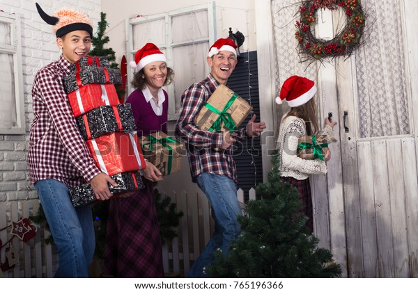 efaa35b91 Joyful Family Santa Hats Goes On Stock Photo (Edit Now) 765196366