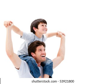 Joyful father giving piggyback ride to his son against a white background
