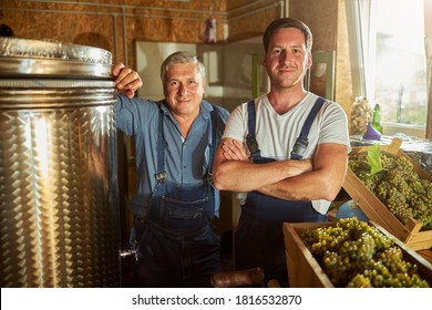 Joyful father and son standing at the winery while looking at the camera