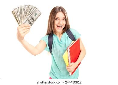 Joyful female student holding money isolated on white background