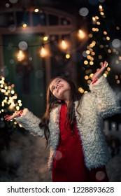 joyful fun of a young girl in a winter evening