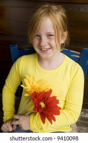 joyful girl with flowers and freckles