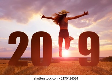 Joyful girl jumping while the celebration of the new year 2019.