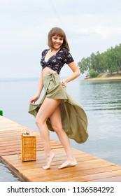Joyful girl on the background of the gulf