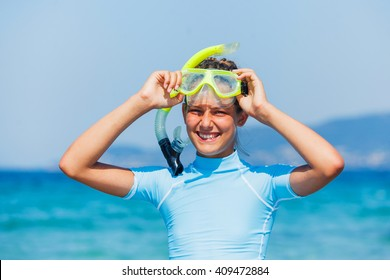 Joyful girl in yellow mask going scuba diving.