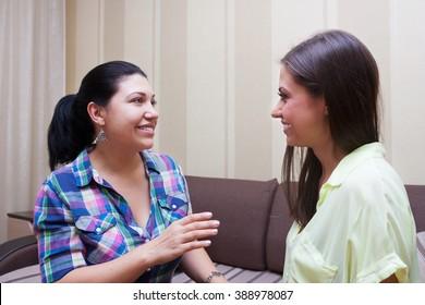 joyful girlfriend spoken at home on the sofa