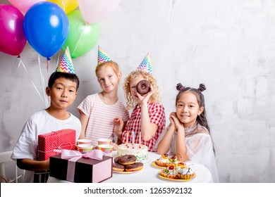 joyful group of happy children standing near the table. closeup photo