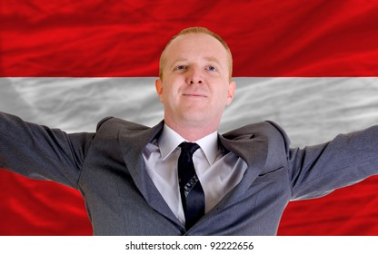 joyful investor spreading arms after good business investment in austria