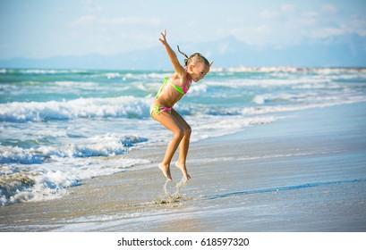 joyful jumping to the sea