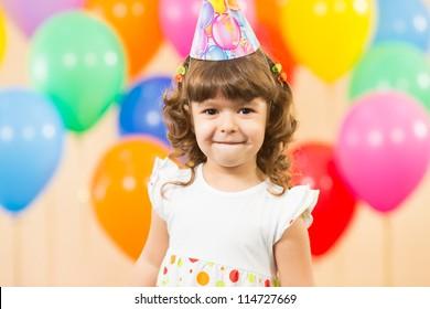 joyful kid girl on birthday party