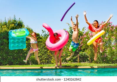 Joyful kids having fun during summer pool party