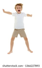 Joyful little boy fun jumping and waving his arms. Dressed in a pure white T-shirt on which you can draw or write any advertising text. Isolated on white background.