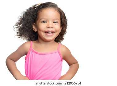 Joyful little girl with an afro hairstyle smiling isolated on white