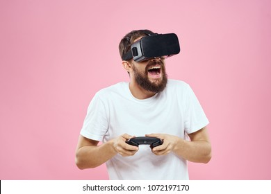 joyful man in 3d glasses plays a console, virtual reality