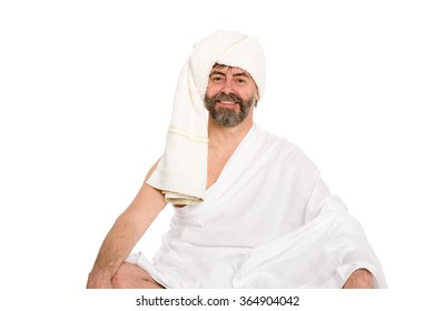 Joyful man dressed in the sauna in a turban. From a series of Russian bath.