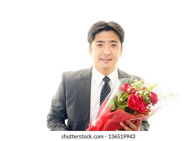 Joyful man holding flowers
