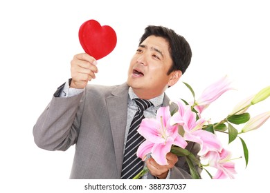 Joyful man holding flowers