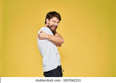 joyful man hugs himself, studio, bright background, logo
